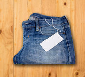 Jeans texture on wood Royalty Free Stock Images