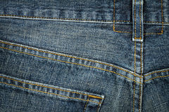 Jeans texture. Worn blue denim jeans texture with stitch Stock Images