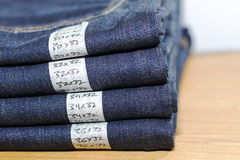 Jeans. A tidy stack of jeans in a retail envionment. Full size break Royalty Free Stock Photo