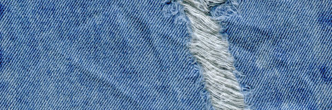 Jeans torn denim texture. Denim jeans ripped Royalty Free Stock Photography