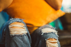 Jeans torn at the knee Stock Image