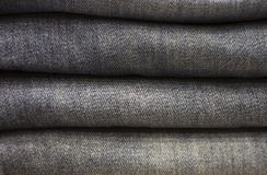 Jeans traver närbilden, textur, bakgrund arkivbilder