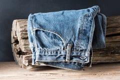 Jeans with tree stump Stock Photos