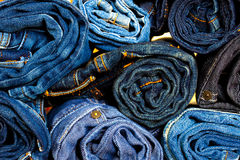 Jeans trousers rolls Stock Photography