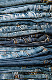 Jeans trousers stack close up Royalty Free Stock Photos
