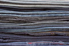 Jeans trousers stack closeup Stock Photos