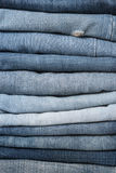 Jeans trousers stack closeup Stock Photo