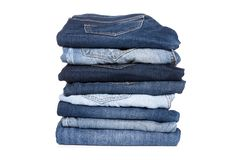 Jeans trousers stack on white background royalty free stock image