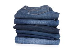 Jeans trousers stack on white background stock image