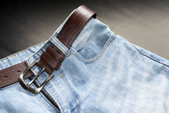 Jeans upper and belt isolate on black gray background Royalty Free Stock Image