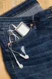 Jeans with walkman. Blue jeans with a walkman in the pocket Stock Photos