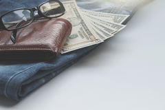 Jeans, wallets, dollar, glasses for the financial and tourism ba Stock Photos