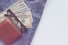 Jeans, wallets, dollar, glasses for the financial and tourism ba Royalty Free Stock Photos