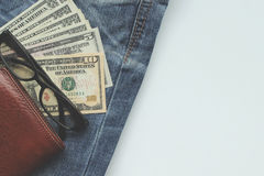 Jeans, wallets, dollar, glasses for the financial and tourism ba Royalty Free Stock Photo