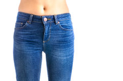 Jeans, Woman waist wearing jeans Stock Image