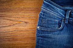 Jeans on wood royalty free stock photo