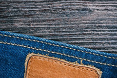 Jeans and wood background Stock Photos