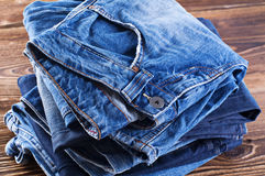 Jeans on wood board Stock Photography