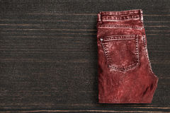 Jeans on wooden background Royalty Free Stock Photo