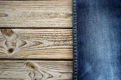 Jeans on a wooden background on the right. horizontal Stock Photography