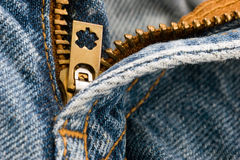 Jeans Zipper. Close up of the zipper on the front of a pair of jeans pants royalty free stock photo