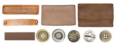 Jeansetiketter och knappar Fotografering för Bildbyråer