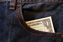 Jeansfack med en dollar sedlar Fotografering för Bildbyråer