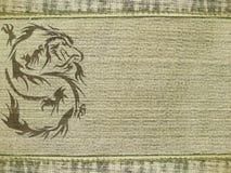 Jeanshintergrund mit Drachen Stockfotografie