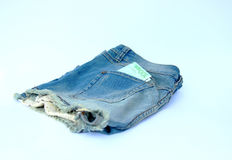 Jeanskortslutningar med euro 100 Arkivfoton