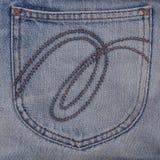 Jeanstasche auf Baumwollstoffbeschaffenheit für Muster Stockbild