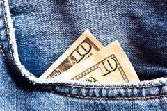 Jeanstasche und zwei 10 Dollar Banknoten Stockfotografie