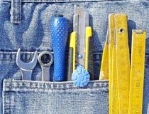 Werkzeuge und Jeanstasche Lizenzfreies Stockbild