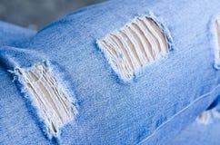 Jeanstextuur als achtergrond, textuur van Denimjeans of achtergrond de de gescheurde van denimjeans met oud De oude jeans van het stock foto