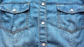 Jeanstextuur, blauwe achtergrond, abstractie, kleren, stof stock fotografie