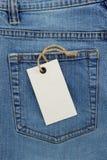 Jeanstextuur en prijskaartje Stock Foto's