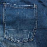 Jeanstextuur met zak voor achtergrond stock afbeelding