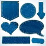 Jeanstorkdukebeståndsdelar. Objekt som isoleras på vit Arkivfoton