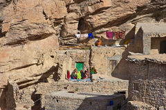 Jebel Akhdar Cliff Hamlet. Omani women relaxing outside a traditional stone house in a small cliff hamlet near Sroot in the Jebel Akhdar mountains of the royalty free stock photography