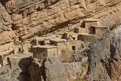 Jebel Akhdar Cliff Hamlet. Traditional stone houses in a small cliff hamlet near Sroot in the Jebel Akhdar mountains in the Sultanate of Oman stock photography
