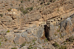 Jebel Akhdar Cliff Hamlet. Traditional stone houses in a small cliff hamlet near Sroot in the Jebel Akhdar mountains in the Sultanate of Oman stock images
