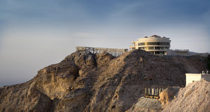 Jebel Hafeet Mountain and palace. Jebel Hafeet is a mountain primarily in the United Arab Emirates on the outskirts of Al Ain. The mountain actually straddles Stock Image