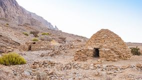 Jebel Hafeet Tombs. The Jebel Hafeet Tombs are 5,000 year old beehive tombs composed of stacked natural and edged stones. The site is located near the Omani royalty free stock photos