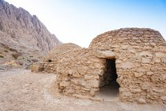 Jebel Hafeet Tombs. The Jebel Hafeet Tombs are 5,000 year old beehive tombs composed of stacked natural and edged stones. The site is located near the Omani royalty free stock images