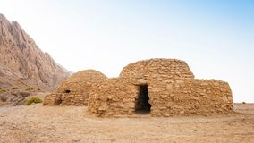 Jebel Hafeet Tombs in the UAE. The Jebel Hafeet Tombs are 5,000 year old beehive tombs composed of stacked natural and edged stones. The site is located near the stock photos