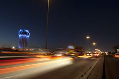 Jeddah water tower at night, with car lights motion. On the highway. Saudi Arabia Royalty Free Stock Photo