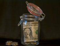 Jeden amerykański dolarowy oszczędzanie w słoju Obrazy Royalty Free