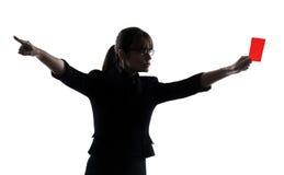 Biznesowa kobieta pokazuje czerwonej kartki sylwetkę zdjęcia royalty free