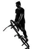 Mężczyzna bmx postaci akrobatyczna sylwetka zdjęcie stock