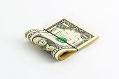 Jeden dolara banknoty staczający się up z rubberband. Obraz Stock