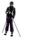 Jeden kobiety narciarki narciarstwo stoi przyglądającą oddaloną sylwetkę Zdjęcia Royalty Free